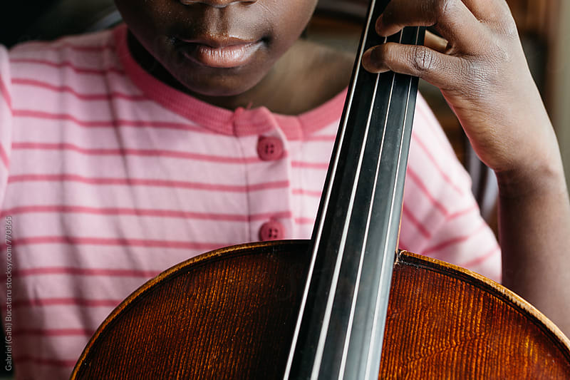 African American girl with cello by Gabriel (Gabi) Bucataru for Stocksy United