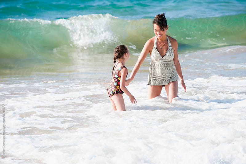 Mother and Daughter Playing at Beach by Ronnie Comeau for Stocksy United
