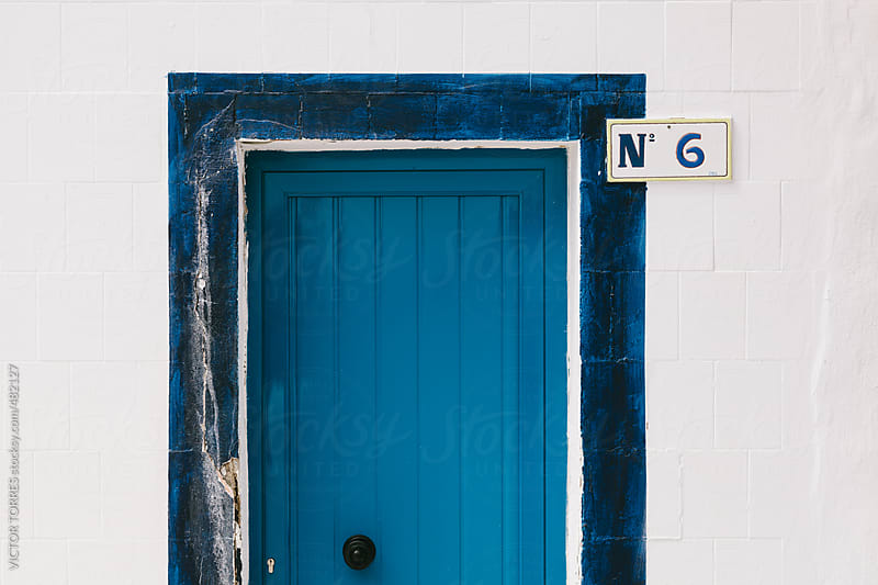 Blue Door on a White Traditional Facade by VICTOR TORRES for Stocksy United