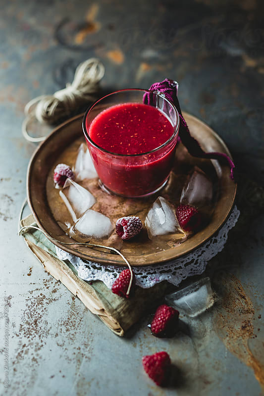 Cold raspberry smoothie by Tatjana Ristanic for Stocksy United