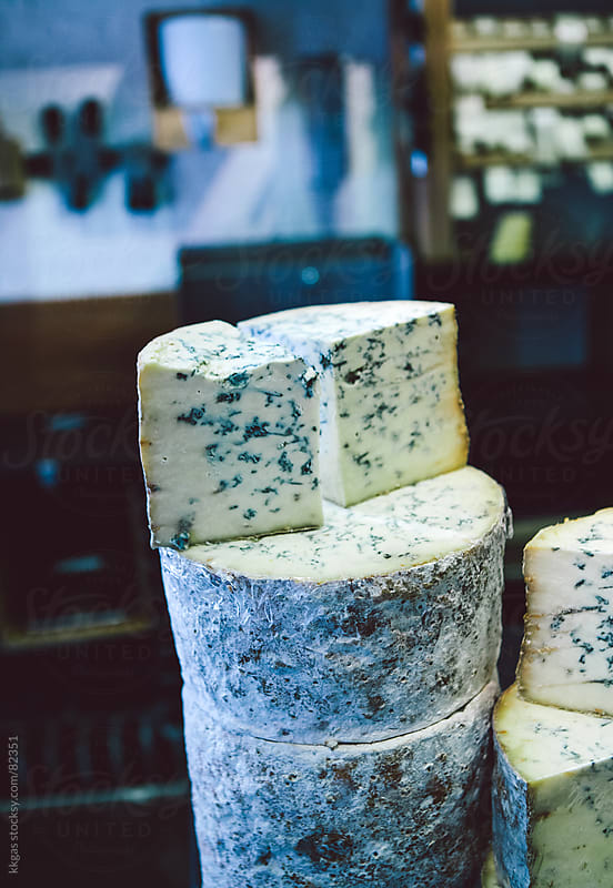 A stack of soft blue cheeses by kkgas for Stocksy United