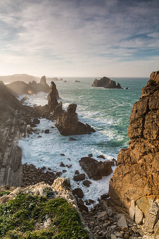 Seascape on the edge of a cliff by Marilar Irastorza for Stocksy United