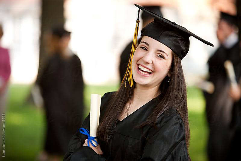 Graduation: Pretty, Smiling High School Graduate by Sean Locke for Stocksy United