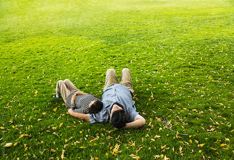 Senior couple relaxed on grass by yuko hirao for Stocksy United