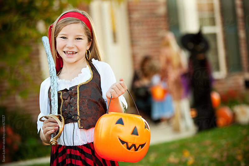 Halloween: Laughing Pirate Girl on Halloween Night by Sean Locke for Stocksy United