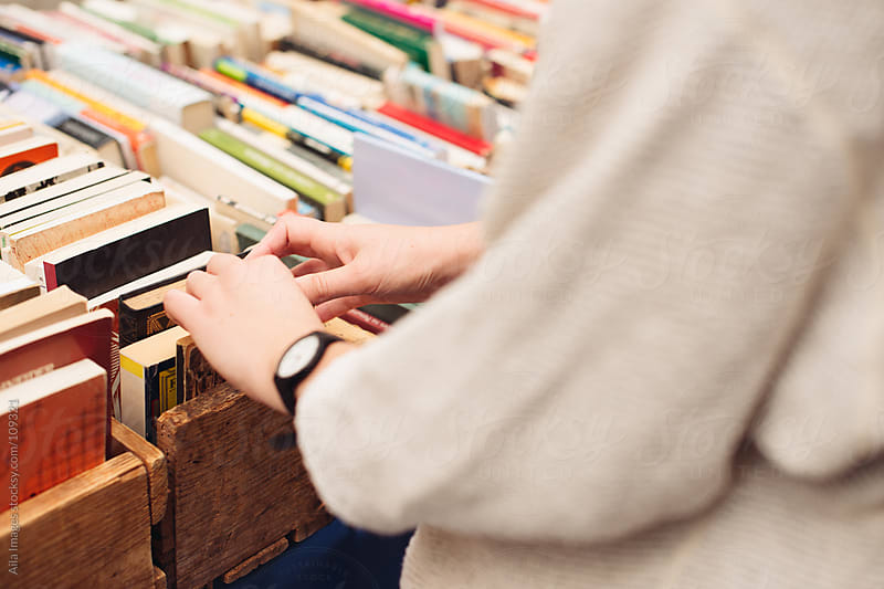 Shopping at second hand book stall by Aila Images for Stocksy United