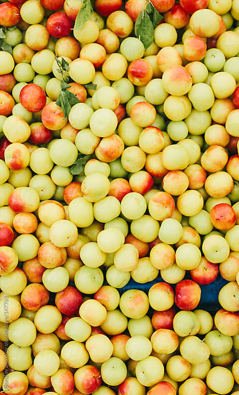 Fresh juicy plums in the market by Borislav Zhuykov for Stocksy United