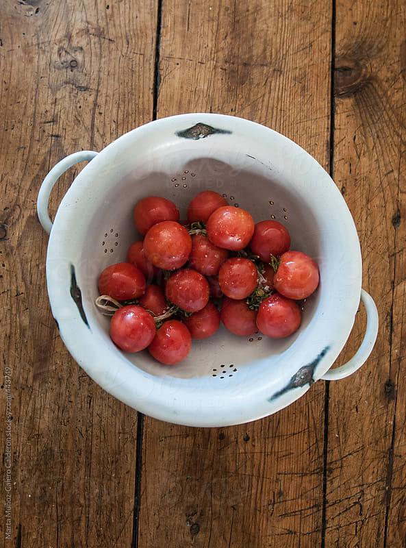 Tomatoes in a colander by Marta Muñoz-Calero Calderon for Stocksy United