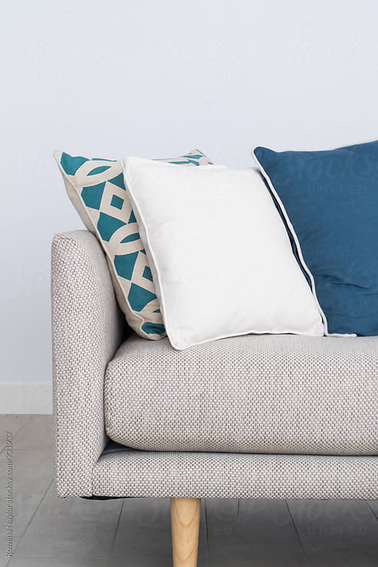 Contempoary lounge with blue cushions by Rowena Naylor for Stocksy United