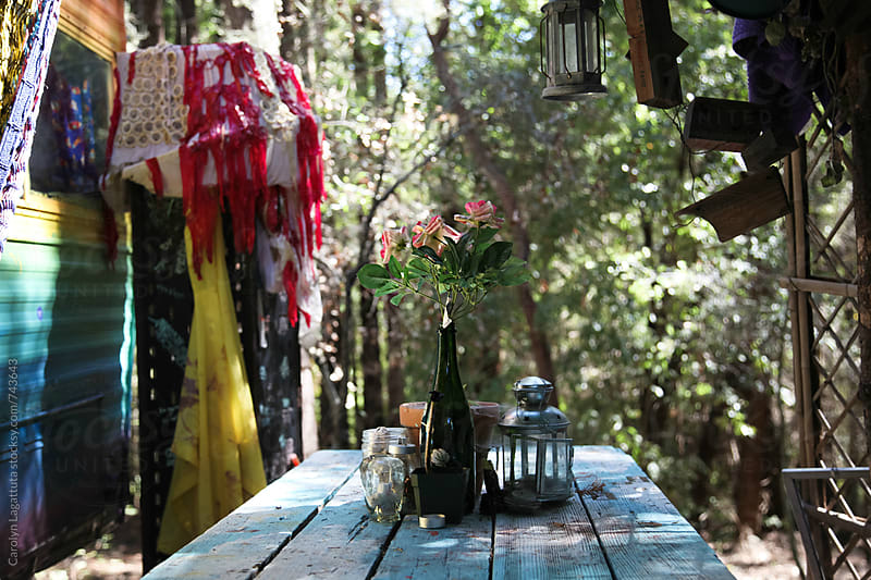 Decorated campground with flowers, lanterns and fabric by Carolyn Lagattuta for Stocksy United
