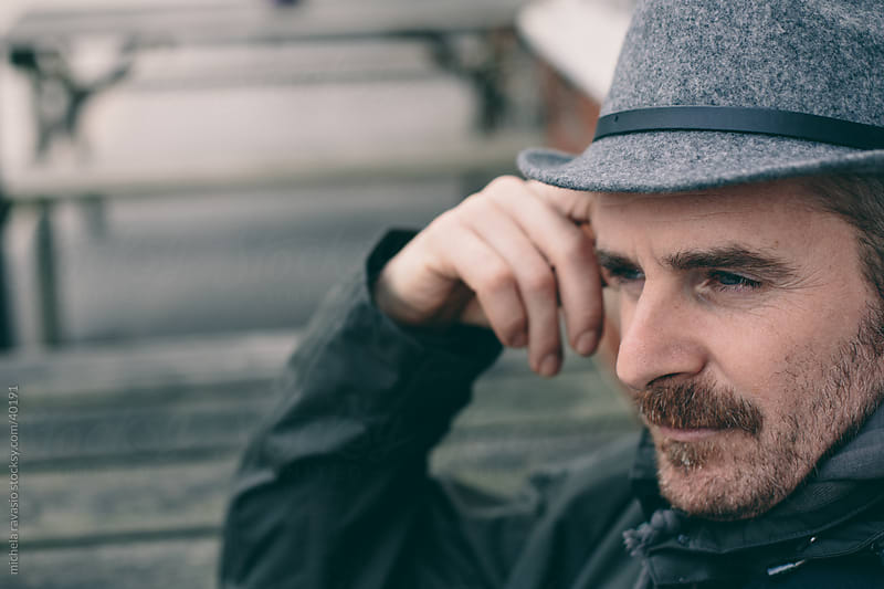 Portrait of a man with a hat by michela ravasio for Stocksy United