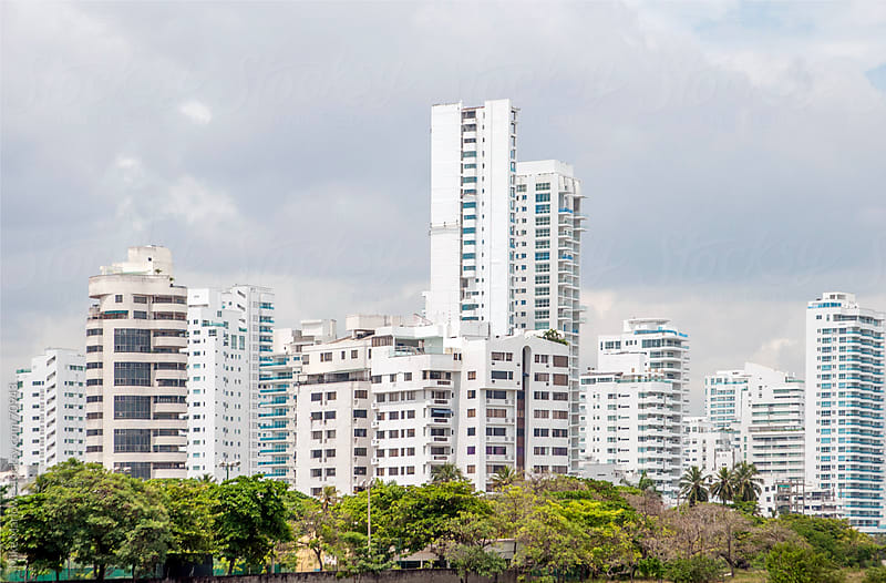 White, tall buildings in a group forming part of a newly built c by Mike Marlowe for Stocksy United
