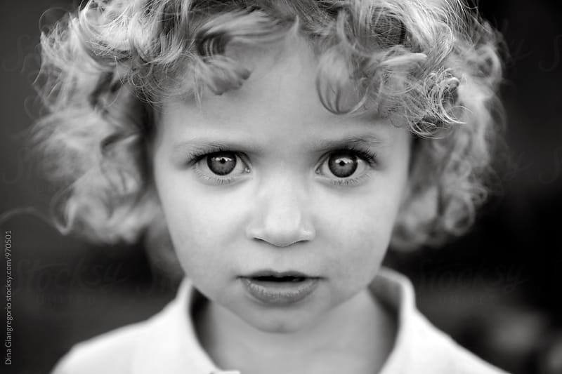 Intense Portrait Of Blonde Curly Haired Toddler by Dina Giangregorio for Stocksy United