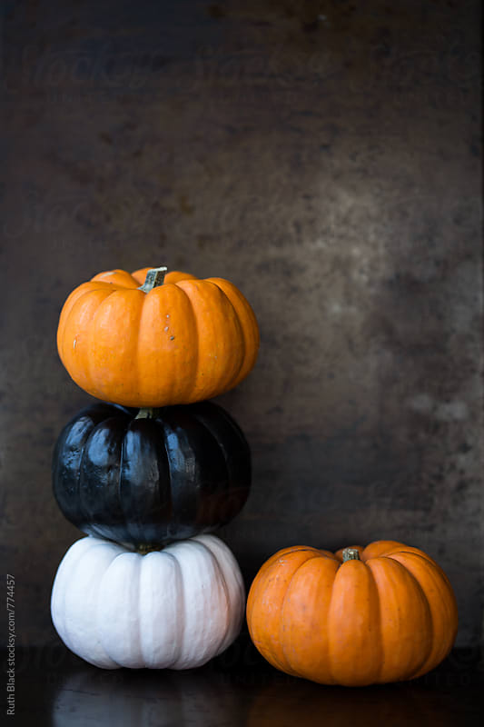 Stack of pumpkins by Ruth Black for Stocksy United