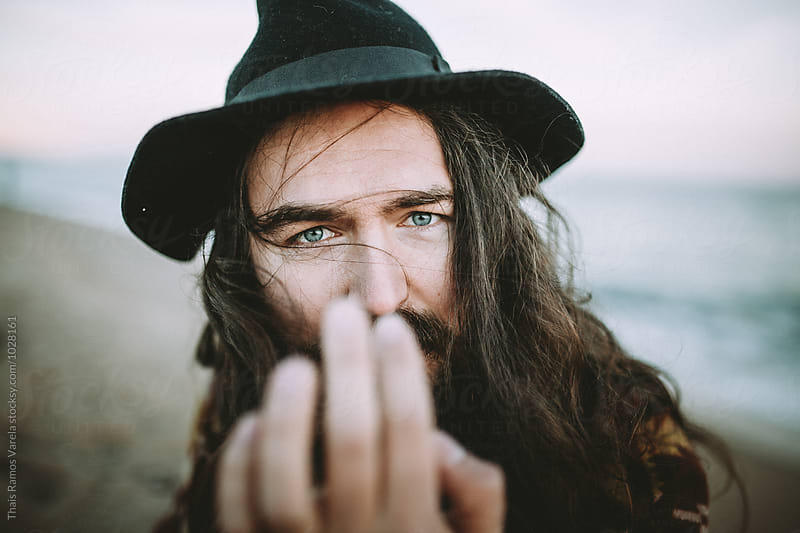 portrait of a long haired man by Thais Ramos Varela for Stocksy United