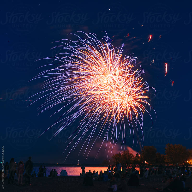 People watching Canada Day fireworks by Jen Grantham for Stocksy United
