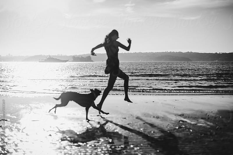 Woman playing with her dog by Mauro Grigollo for Stocksy United