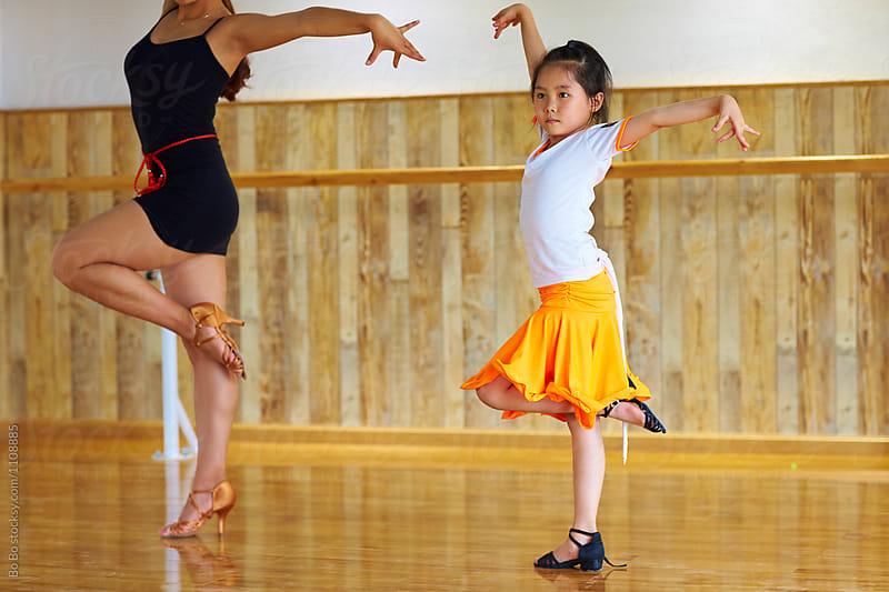 little asian girl learning dance