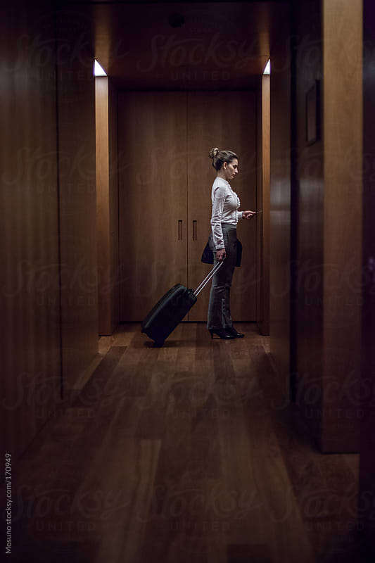 Woman Entering the Room in a Hotel by Mosuno for Stocksy United