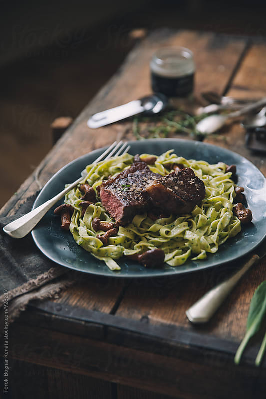 Steak with homemade pasta with wild garlic by Török-Bognár Renáta for Stocksy United
