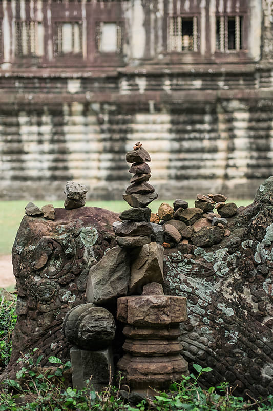 Rock Balancing by tourists at Angkor Wat, Cambodia by Rowena Naylor for Stocksy United