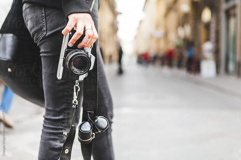 Young Photographer Standing on a Street with an Old Analog Camera by Giorgio Magini for Stocksy United