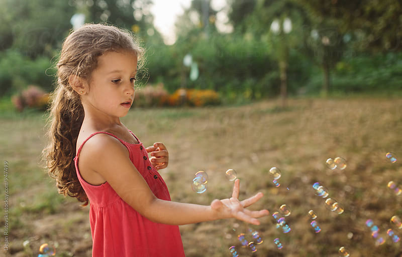 playful child with bubbles. by Dejan Ristovski for Stocksy United