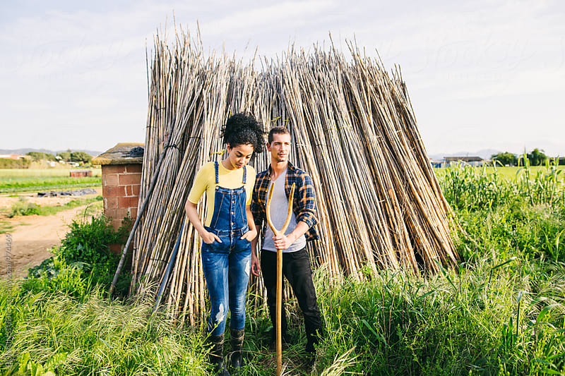Farmer couple in the garden. by BONNINSTUDIO for Stocksy United