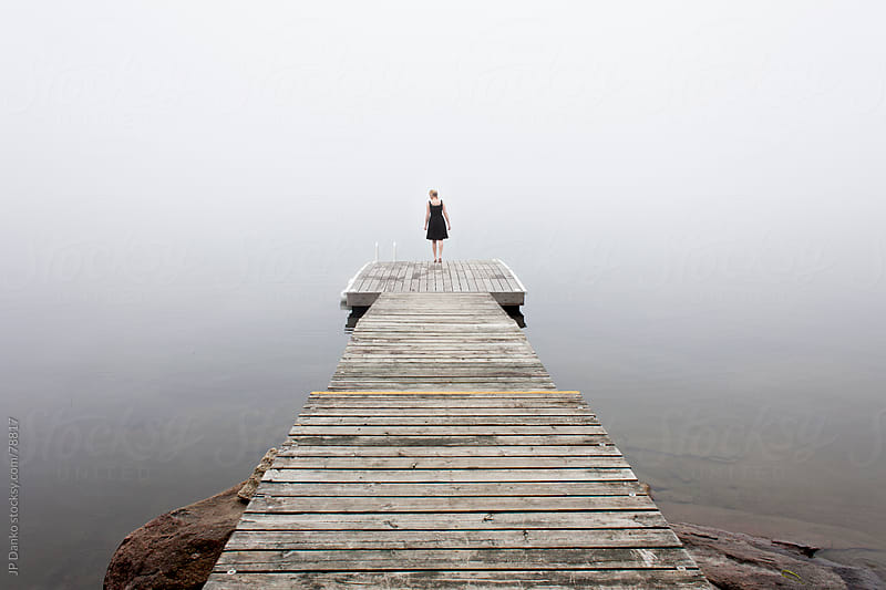 Woman On Cottage Dock in Early Morning at Lake by JP Danko for Stocksy United