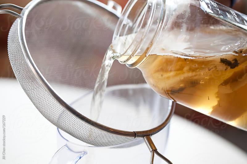 Straining Kombucha Tea by Jill Chen for Stocksy United