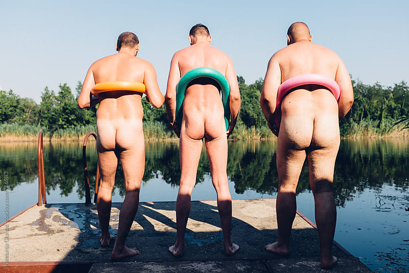 Three Funny Naked Man on a Dock With Floating Devices by Nemanja Glumac for Stocksy United