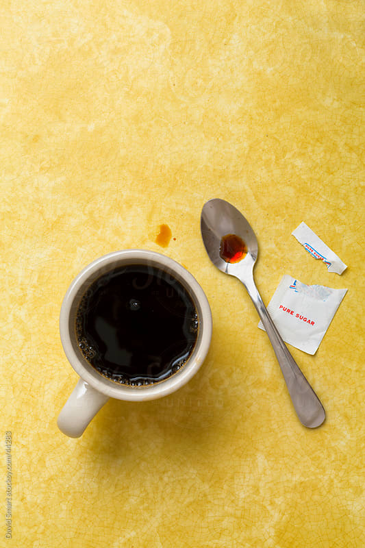Retro coffee mug, spoon and sugar packet on diner counter by David Smart for Stocksy United