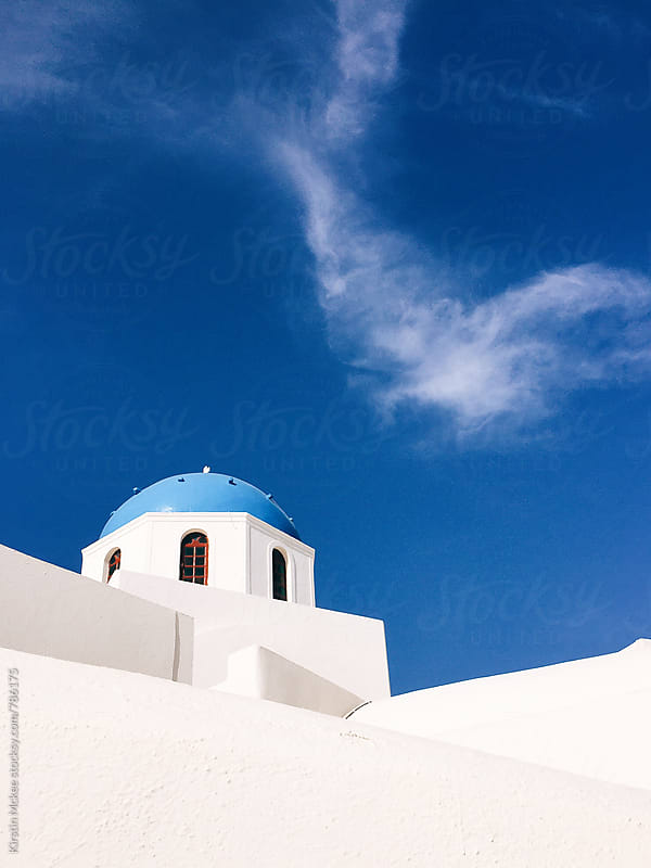 Church and sky in Oia, Santorini by Kirstin Mckee for Stocksy United