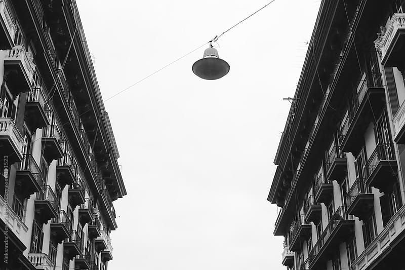 Black and white shot of two buildings in Naples, Italy by Aleksandar Novoselski for Stocksy United