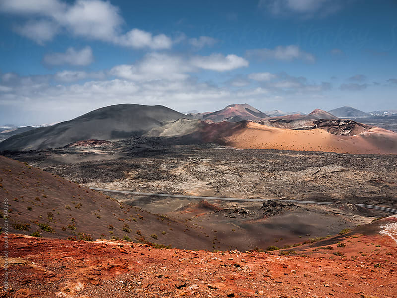 Road going through Volcano Landscape in Lanzarote's Timanfaya National Park by Andreas Wonisch for Stocksy United