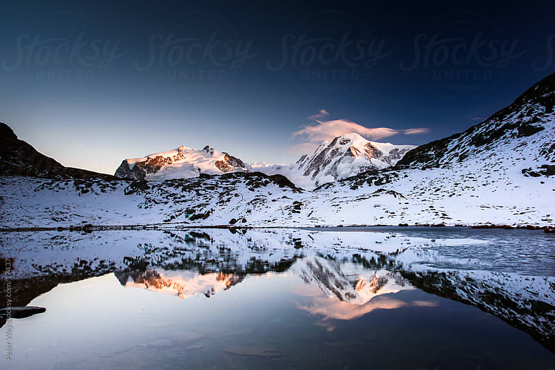 Mountain lake sunset: Monte Rosa and Lyskamm from Riffelsee by Peter Wey for Stocksy United