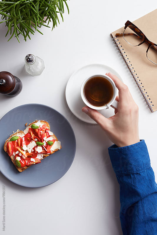 Close-up of delicious vegetarian toast with hot tea by Martí Sans for Stocksy United
