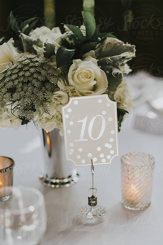 Barn Wedding Reception Table Number by Alicia Magnuson Photography for Stocksy United