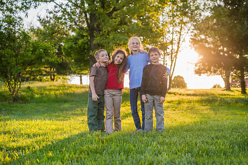 Children: Group of Friends in Backyard at Sunset by Brian McEntire for Stocksy United