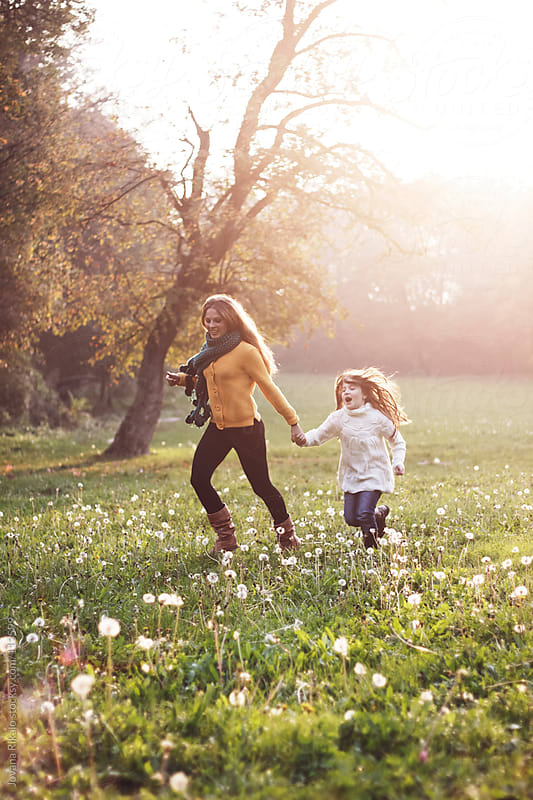 Two girls running and having fun in park by Jovana Rikalo for Stocksy United