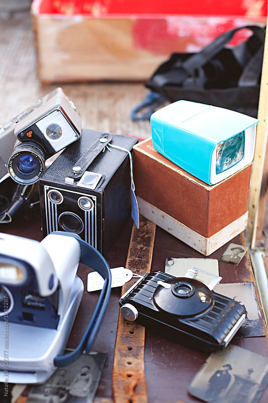 Collection of old cameras for sale at a flea market by Natalie JEFFCOTT for Stocksy United