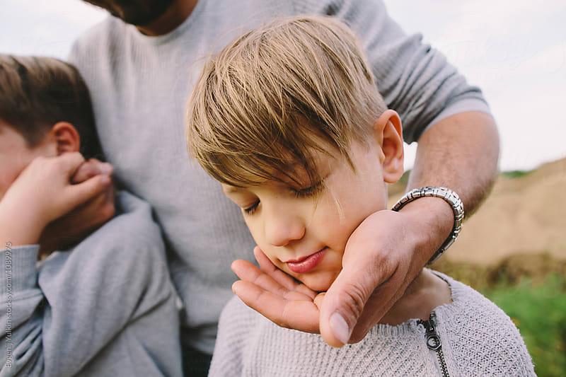 Father holding his boy's head by Evgenij Yulkin for Stocksy United