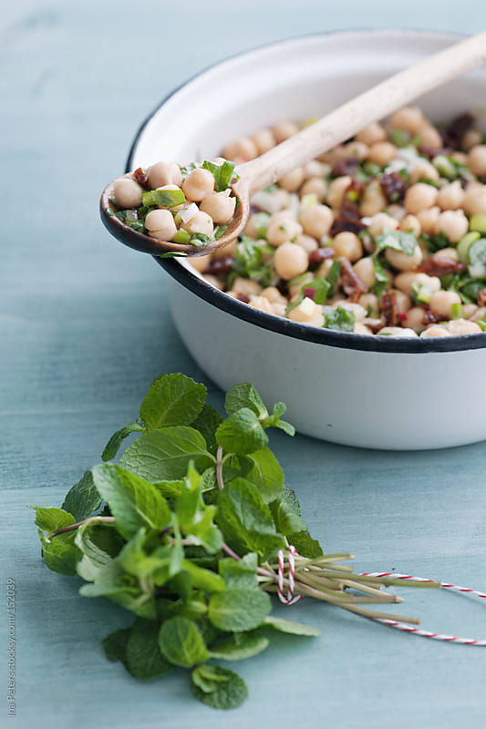 Food: Chickpea Salad with Dried Tomatos, Green Onions, Mint and  by Ina Peters for Stocksy United