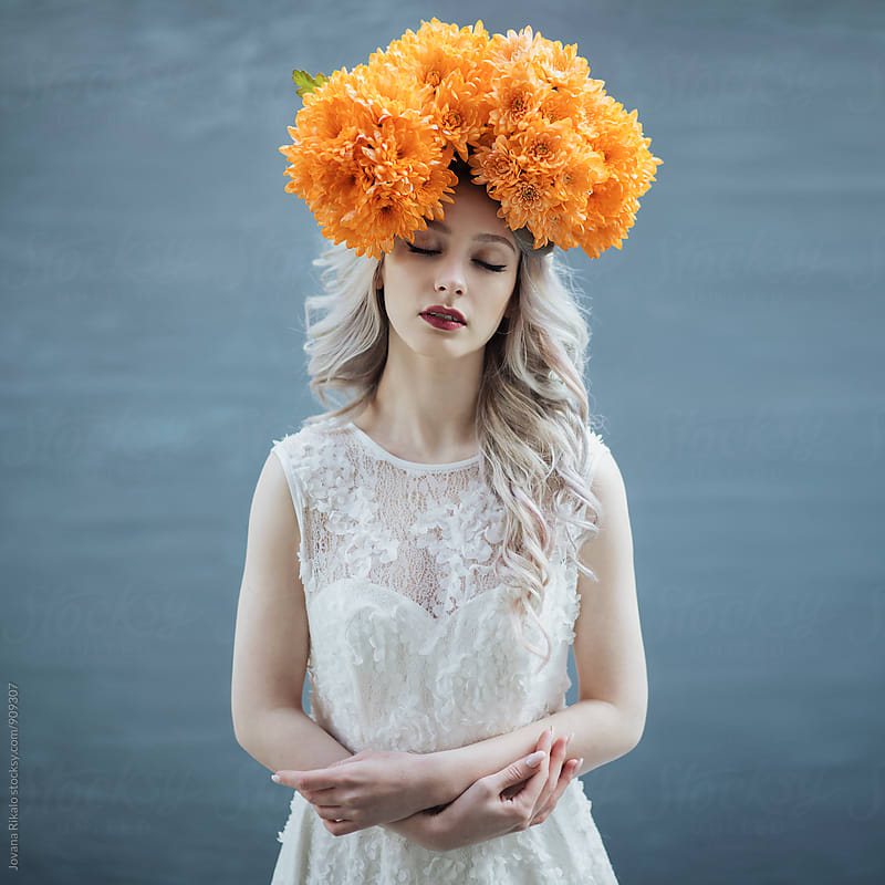 Portrait of a beautiful young woman wearing floral hat by Jovana Rikalo for Stocksy United