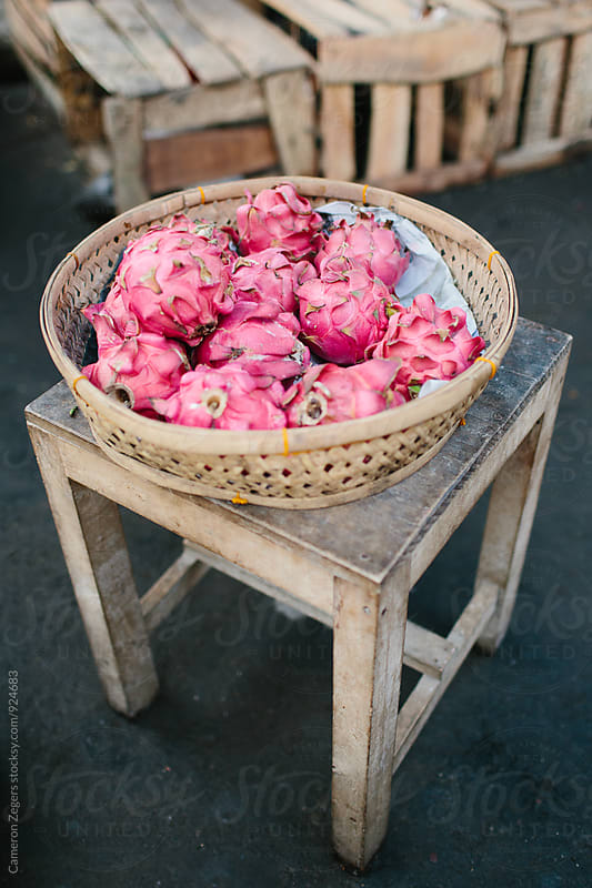 dragon fruit at market in Bali by Cameron Zegers for Stocksy United