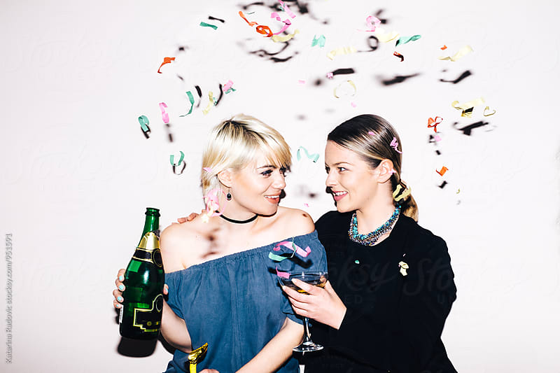 Two Pretty Friends Drinking Champagne by Katarina Radovic for Stocksy United