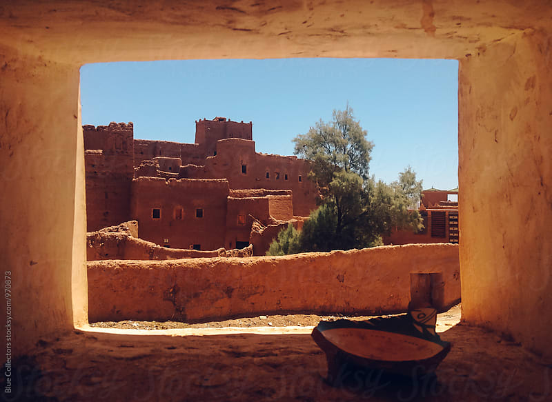 Kasbah views in Morocco through a window by Jordi Rulló for Stocksy United