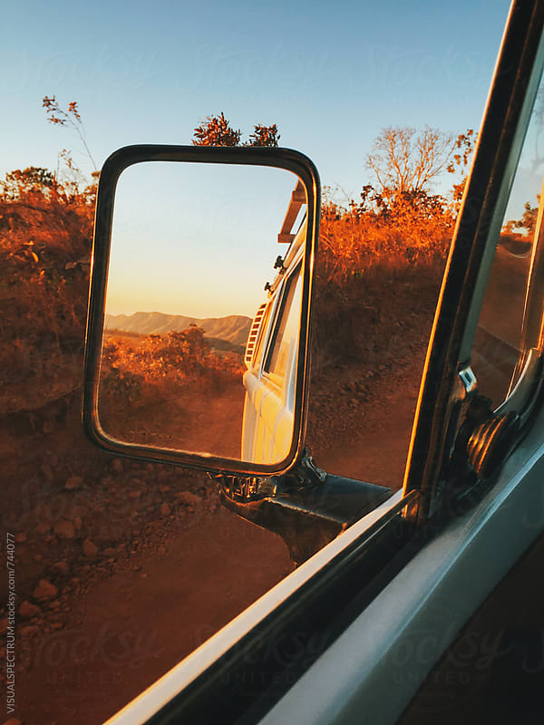 Dry Wilderness at Sunset Seen Through Rear Mirror (Chapada dos Veadeiros, Brazil) by VISUALSPECTRUM for Stocksy United