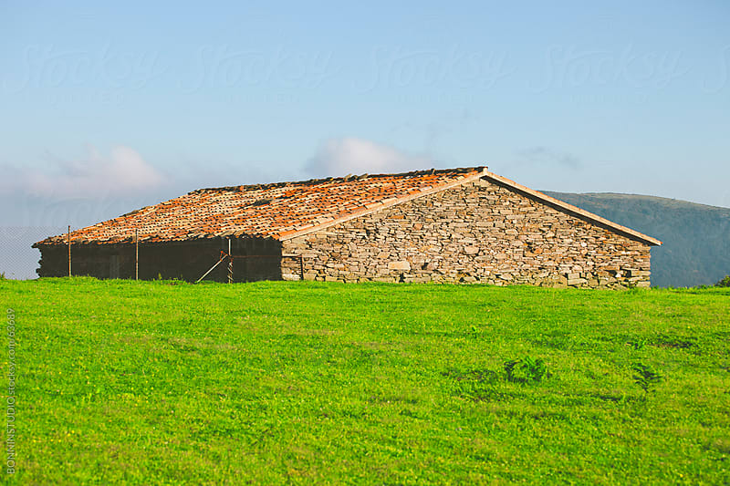 Rural house on a green field. Landscape on Catalunya, Spain. by BONNINSTUDIO for Stocksy United