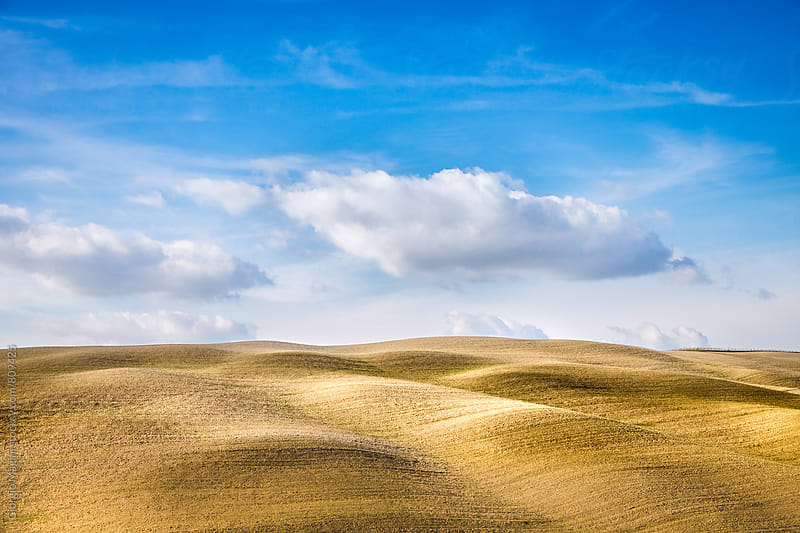 Plowed Fields Under the Blue Sky of the Val d'Orcia in Italy by Giorgio Magini for Stocksy United